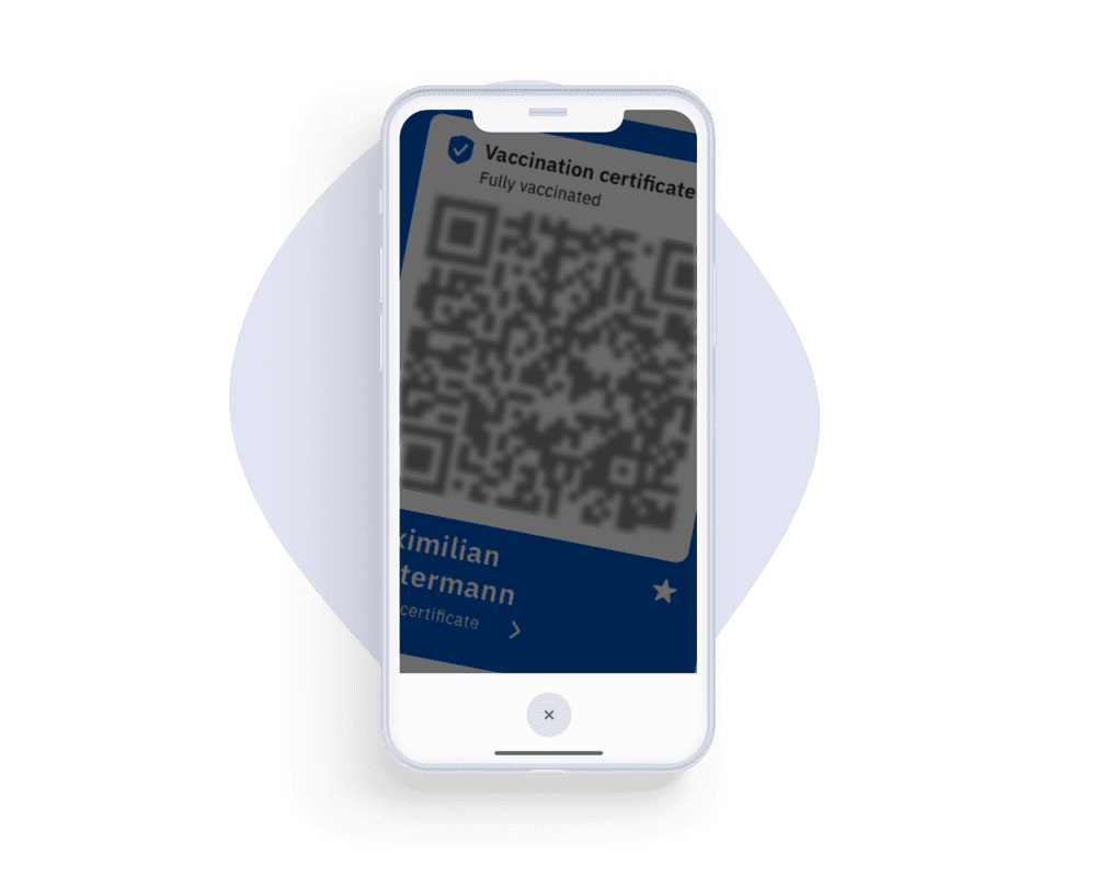 A smartphone scans the QR code on a test certificate.